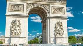The Arc de Triomphe Triumphal Arch of the Star timelapse is one of the most famous monuments in Paris. Standing at the western end of the Champs-Elyseees stock video footage