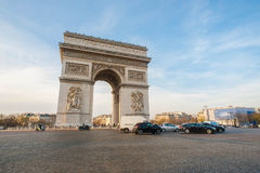 Arc de Triomphe. A world famous sightseeing Arc de Triomphe (a Victory Arch) at the Place Charles de Gaulle in downtown Paris, France on a wonderful winter Royalty Free Stock Photo