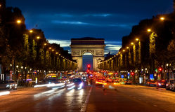 Arc de Triompthe in evening. Arc de Triompthe and Champs Elysees in evening, France Stock Photography