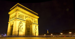 Arc de Triumph. Panoramic image of the famous Arc de Triumph at night, Paris, France Royalty Free Stock Image