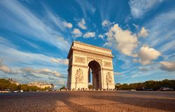 Arc de Triumph in Paris with beautiful clouds behind in Fall. Arc de Triumph in Paris with beautiful clouds behind on a bright afternoon in Autumn. Panoramic Royalty Free Stock Images