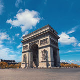 Arc de Triumph in Paris on a bright day. Arc de Triumph in Paris, France on a bright day under spectacular clouds. Vertical panorama image, all cars removed from Stock Image