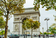 Arc de Triumph, Paris. With cars and people during fall Stock Image