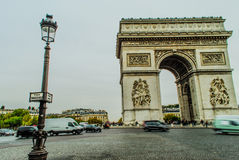 Arc de Triumph, Paris. With cars and people during fall Royalty Free Stock Photos