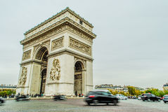Arc de Triumph, Paris. With cars and people during fall Stock Images