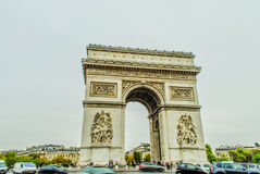 Arc de Triumph, Paris. With cars and people during fall Stock Photography
