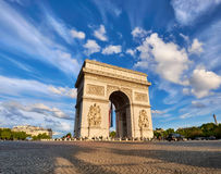Arc de Triumph in Paris, France, on a bright afternoon. With feather clouds behing, panoramic image Royalty Free Stock Images