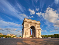 Arc de Triumph in Paris, France, on a bright afternoon. With feather clouds behing, panoramic image Royalty Free Stock Photo
