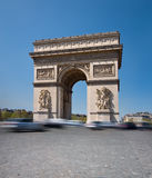 Arc de Triumph in Paris, France. Text space. Long exposure to show movement of the cars on the roundabout Royalty Free Stock Photography