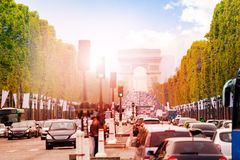 Arc de triumph at Paris. Traffic jam on the way toward Triumphal arc in Paris at the sunny autumn day Royalty Free Stock Photography