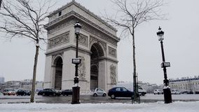 The arc de triumph by a rare snowy day in Paris, France. Europe stock video footage
