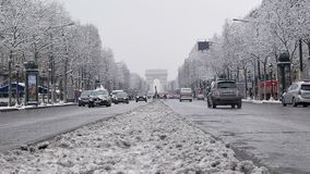 The arc de triumph by a rare snowy day in Paris, France. Europe stock footage
