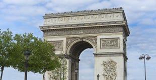 Arc de Triumphe Monument Paris. Arc de Triumphe monument popular tourist destination Paris with blue cloudy sky Stock Image