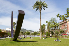 Arc de Venet in in Albert 1er Gardens in Nice. NICE, FRANCE - MAY 11, 2014: Arc de Venet, metal sculpture by Bernar Venet (1988),  located in Albert I Gardens Stock Photography