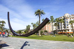 Arc de Venet in in Albert 1er Gardens, Nice. NICE, FRANCE - MAY 11, 2014: Arc de Venet, metal sculpture by Bernar Venet (1988),  located in Albert I Gardens next Royalty Free Stock Photo
