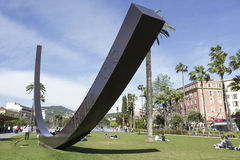 Arc de Venet in Nice. NICE, FRANCE - MAY 11, 2014: Arc de Venet, metal sculpture by Bernar Venet (1988),  located in Albert I Gardens next to the famous Massena Royalty Free Stock Image