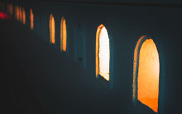 Arc decorated holes in the wall for place candle. Or light source at night. For design with copy space for text or image Royalty Free Stock Photography
