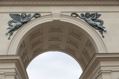 Arc decoration. Arc decorated with angels saluting king Royalty Free Stock Photos