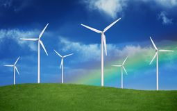 Arc-en-ciel au-dessus de Windfarm Photo stock