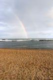 Arc-en-ciel de plage Photographie stock libre de droits