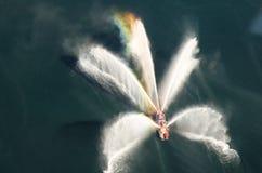 Arc-en-ciel en brouillard de bateau-pompe Image libre de droits