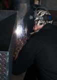 Arc flash light from a welding project. Man welding diamond plate with a mig welder Royalty Free Stock Photos
