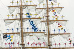 ARC Gloria - Sail Amsterdam 2015. Amsterdam, The Netherlands - August 19, 2015: Cadets from the Naval school on the Colombian ARC Gloria standing on the masts Stock Images