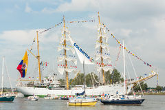 ARC Gloria - Sail Amsterdam 2015. Amsterdam, The Netherlands - August 19, 2015: Cadets from the Naval school on the Colombian ARC Gloria standing on the masts Stock Photos