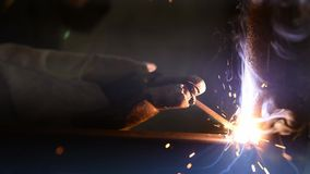 Arc ignition, welding works, work process closeup stock footage