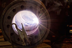 Arc inside of the weldment. The flash of the welding arc is visible in a conditional pass of the repaired pipeline parts Stock Image