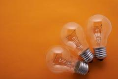 Arc lamps set on an orange background. Three arc lamps set on an orange background Stock Image