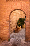 Arc made of brick in Spanish town Royalty Free Stock Photography