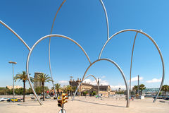 Arc metal sculpture in Barcelona Spain. BARCELONA - JULY 19: Maritime Museum and Placa de les Drassanes on July 19, 2012 in Barcelona. It is former Royal Stock Photos
