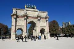 Arc monument in Paris. Tourists in the park near the monument Arc in Paris Stock Photo