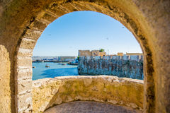 Arc. Nice arc on ocean and old walls view Stock Image