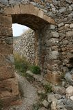 The arc in the old stone wall. Of the Venetian fortress on the small Mediterranean island Spinalonga near Crete Royalty Free Stock Photos