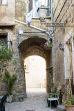 Arc in old village. Little street with arc  in an ancient village called Calcata, near Rome Italy Stock Images