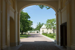 Arc in Palace Wall. View of the landscape park through arch in wall Royalty Free Stock Image