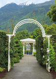 Arc passage. In a garden in the mountain setting Stock Photo