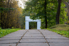 Arc passage in the forest Royalty Free Stock Photos