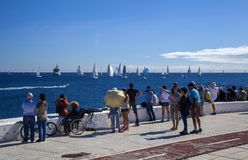 Arc rally start. LAS PALMAS, SPAIN - NOVEMBER 25: Spectators are enjoying beautiful weather on day of departure of ARC 2018, Atlantic Rally for Cruisers, on stock image