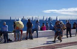 Arc rally start. LAS PALMAS, SPAIN - NOVEMBER 25: Spectators are enjoying beautiful weather on day of departure of ARC 2018, Atlantic Rally for Cruisers, on stock images