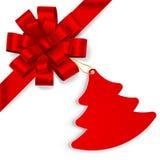 Arc rouge avec l'arbre de Noël Images libres de droits