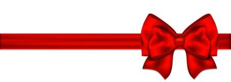 Arc rouge avec le ruban sur un fond blanc Images stock
