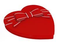 Arc rouge de boîte-cadeau de sucrerie de coeur Photographie stock