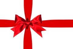 Arc rouge et ruban de cadeau d'isolement Photos stock