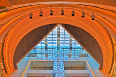 Arc shaped modern building roof. Modern building upward view on arch shaped roof with lighting Stock Photo