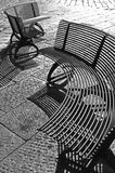 Arc shaped, public seating in Italy. Metallic, arc shaped seating in a piazza in Elba, Italy Stock Photo