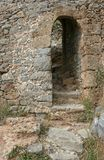 The arc with steps in the old stone wall. Of the Venetian fortress on the small Mediterranean island Spinalonga near Crete Royalty Free Stock Image