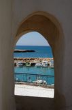 Arc to sea. Sea coastline view through the wall window arc Stock Photo